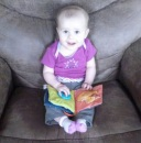 annabel in pop pop's chair with book1